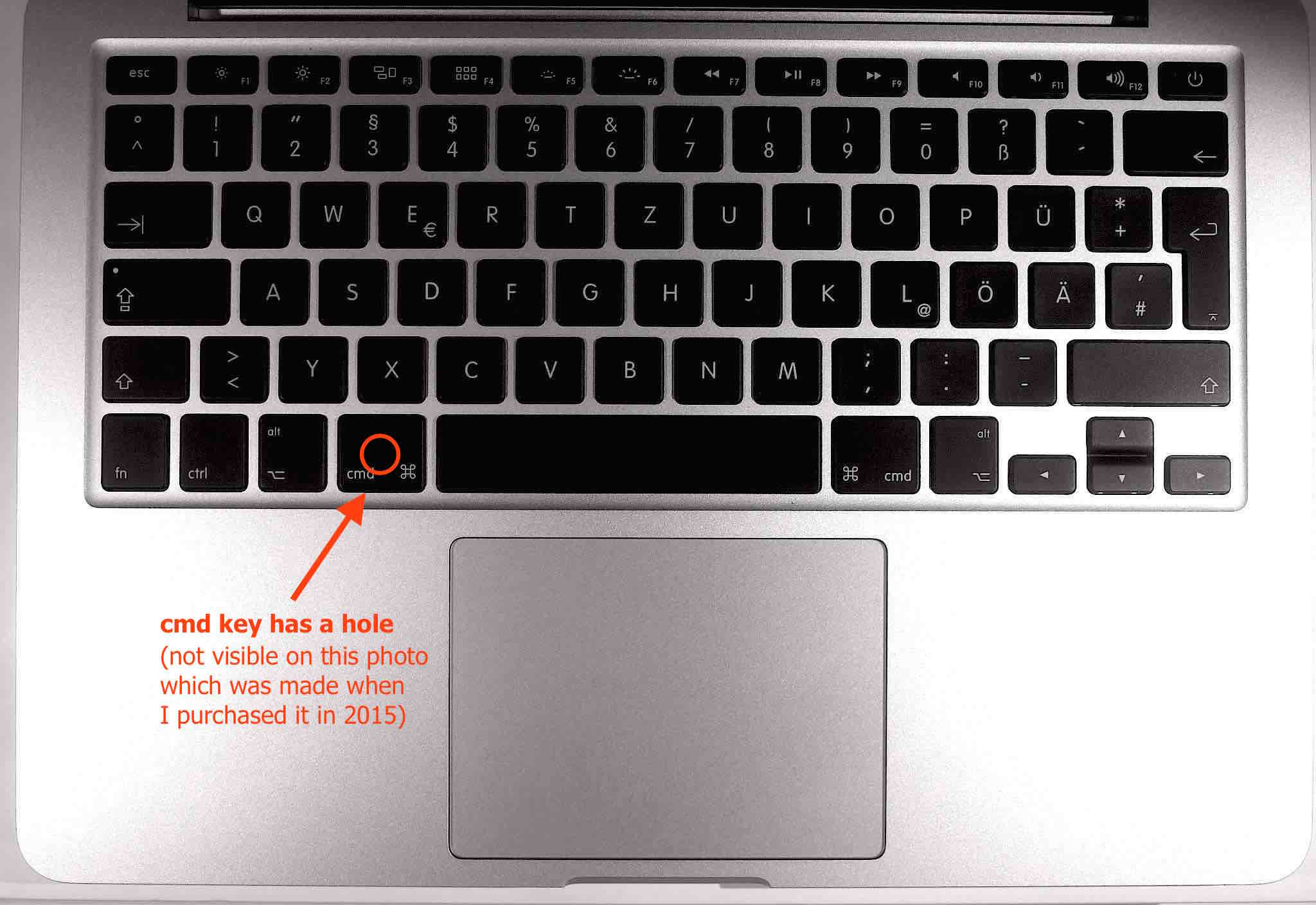 where is the serial number on a macbook pro